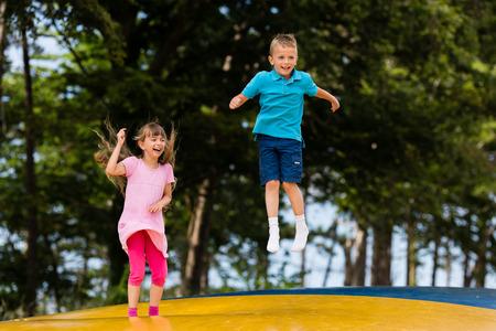 bounce: Young caucasian kids in Denmark on a summer day. Stock Photo