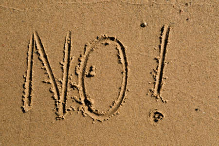 Casual writing in the wet sand on a sunny day. Stock Photo