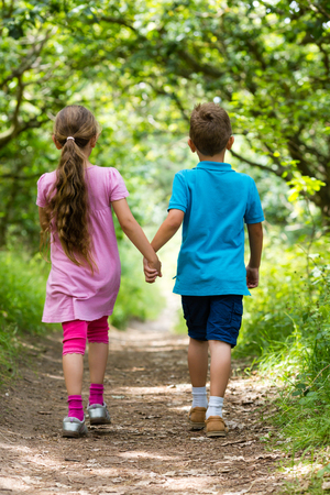 people holding hands: Young caucasian kids in Denmark on a summer day. Stock Photo