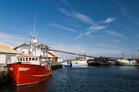 drydock: Old fishing trawler moored in the port while waiting for next fishing trip. Stock Photo