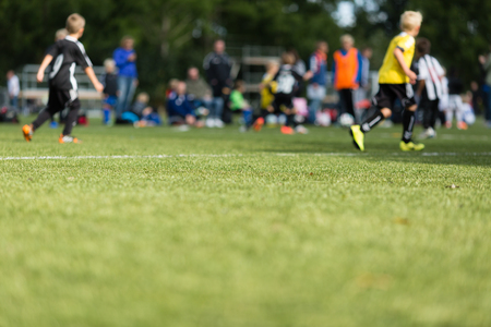 soccer pitch: Picture of kids soccer training match with shallow depth of field. Stock Photo