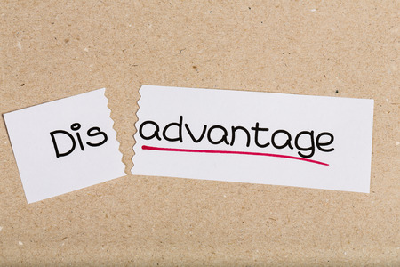 Two pieces of white paper with the word disadvantage turned into advantage photo