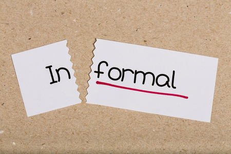 informal: Two pieces of white paper with the word informal turned into formal