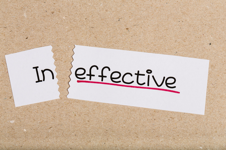ineffective: Two pieces of white paper with the word ineffective turned into effective
