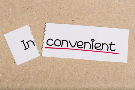 inconvenient: Two pieces of white paper with the word inconvenient turned into convenient