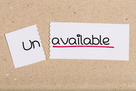 unavailable: Two pieces of white paper with the word unavailable turned into available