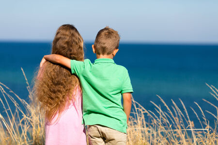 boy long hair: Young caucasian kids in Denmark on a summer day. Stock Photo