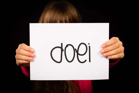 dutch girl: Studio shot of child holding a sign with Dutch word Doei - See you later