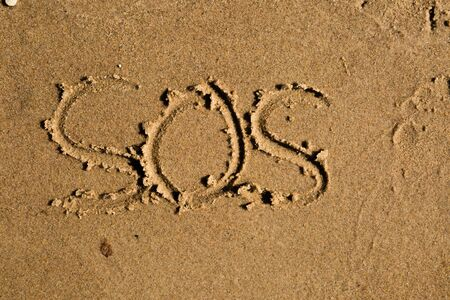 castaway: Casual writing in the wet sand on a sunny day. Stock Photo