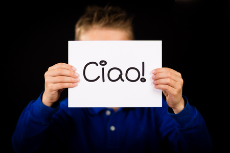 ciao: Studio shot of child holding a sign with Italian word Ciao - Hello