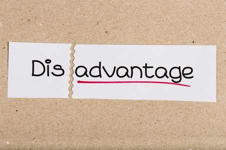mentality: Two pieces of white paper with the word disadvantage turned into advantage
