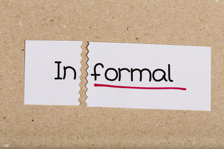 underscore: Two pieces of white paper with the word informal turned into formal