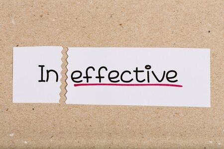 underscore: Two pieces of white paper with the word ineffective turned into effective