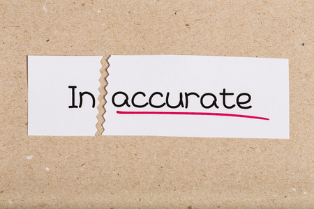 inaccurate: Two pieces of white paper with the word inaccurate turned into accurate Stock Photo