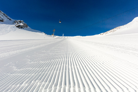 Beautifully groomed ski slope on the Tiefenbach glacier at the popular ski resort Soelden in Austria. photo