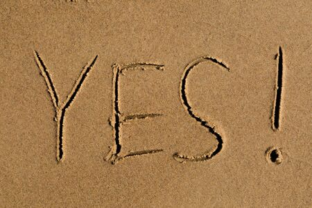 answer approve of: Casual writing in the wet sand on a sunny day. Stock Photo