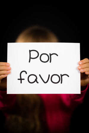 favor: Studio shot of child holding a sign with Spanish words Por Favor - Please Stock Photo