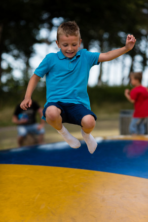 children play area: Young caucasian boy in Denmark on a summer day.