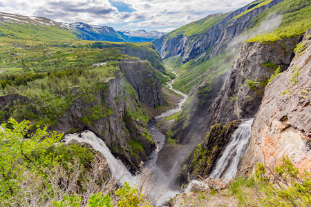 spring landscape: HDR High Dynamic Range photo of the famous Voringsfossen waterfalls near Hardangervidda in Norway is among the most popular tourist attraction during the Norwegian tourism season. Stock Photo