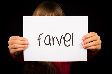 bye: Studio shot of child holding a sign with Danish word Farvel - Bye