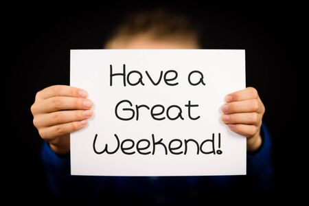 great: Studio shot of child holding a Have a Great Weekend sign made of white paper with handwriting. Stock Photo