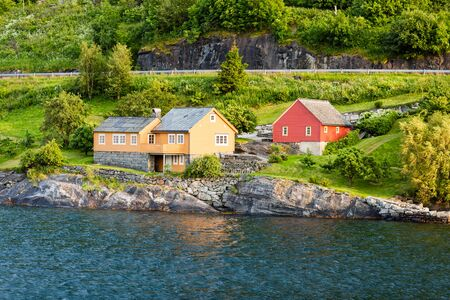 hardangerfjord: Two norwegian holiday homes near the Hardangerfjord in the Western part of Norway. Stock Photo