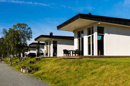 hardangerfjord: Modern holiday home near Hardangerfjord in the Western part of Norway on a summer day. Stock Photo