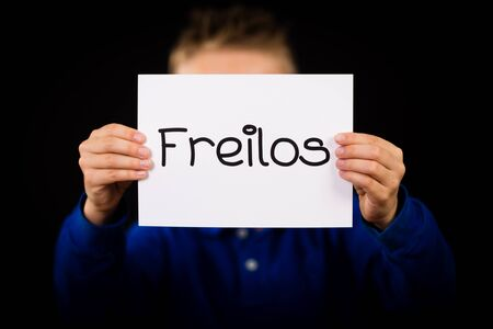 later: Studio shot of child holding a sign with German word Freilos - See You Later