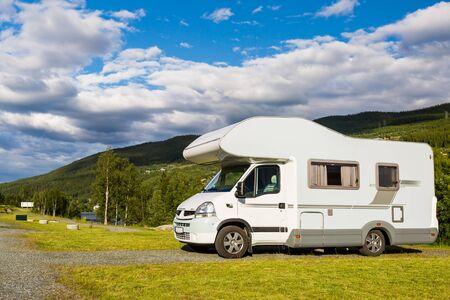 campervan: Modern white campervan at camping site in beautiful nature in Hallingdal, Norway.