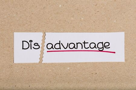 inconv�nient: Two pieces of white paper with the word disadvantage turned into advantage
