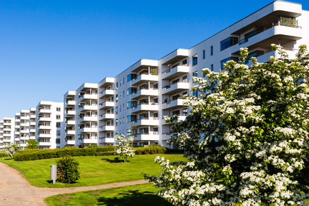 Modern white danish residential condominium building near Copenhagen, Denmark on a sunny day.