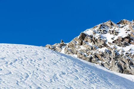 powder snow: Off piste ski tracks on powder snow on a sunny winter day with blue sky. Stock Photo