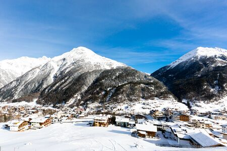 austrian village: The mountain village at the Austrian ski resort Soelden on a cold and sunny winter day. Stock Photo