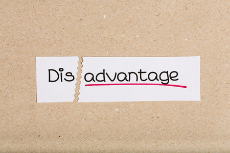 underscore: Two pieces of white paper with the word disadvantage turned into advantage