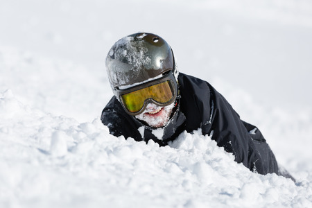 ski goggles: Skier crashed in deep powder snow on a sunny winter day. Stock Photo