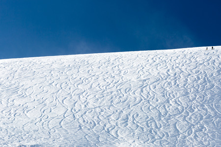 offpiste: Ski slope with fresh powder snow and off piste tracks made by skiers and snowboarders. Stock Photo