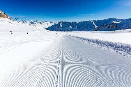 ski run: Groomed ski piste at the Tiefenbach glacier at the ski resort Soelden in Austria. Stock Photo