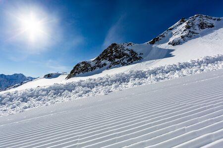 ski run: Beautifully groomed ski slope on the Tiefenbach glacier at the popular ski resort Soelden in Austria.