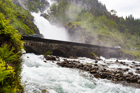 western part: The famous Latefossen waterfalls near the town of Odda in Western part of Norway.