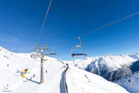 chair lift: Chair lift hovering above the ski slopes at the Austrian ski resort Soelden.