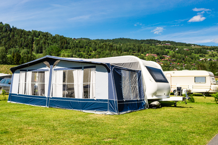 campsite: Modern caravan with caravan tent at campsite in Norway on a sunny summer day.