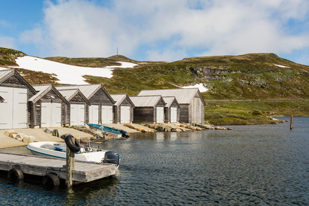 hardanger: Small marina with boats along the road on the Hardangervidda Plateau in Norway.