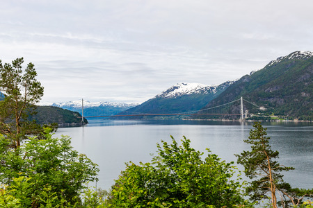hardangerfjord: The newly built Hardangerbrua bridge that spans the Hardangerfjord water close to Ulvik in Western Norway.