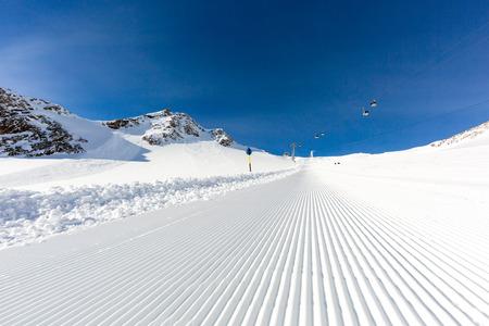 groomed: Beautifully groomed ski slope on the Tiefenbach glacier at the popular ski resort Soelden in Austria.