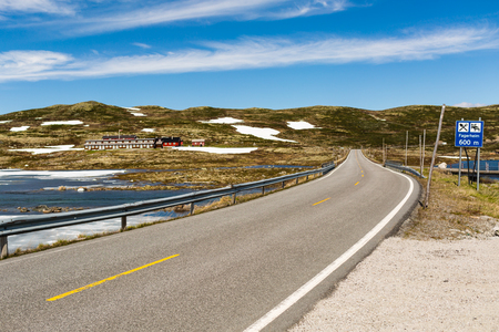 The empty Riksvei 7 public road crossing the large Hardangervidda plateau in Western Norway. Stock Photo