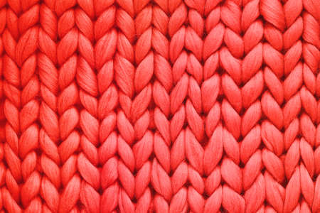 Texture of red wool big knit blanket. Large knitting. Plaid merino wool. Top view Foto de archivo