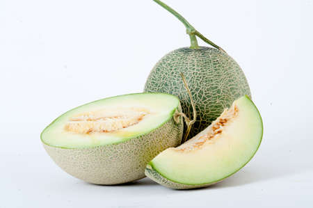 musk: cantaloupe melon,Full and Sliced Cantaloupe Isolated on White Background Stock Photo