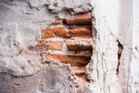 cracked wall: cracked concrete vintage brick wall background,Cracked brick wall Stock Photo