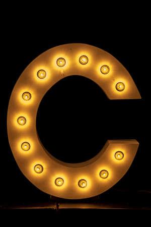 Font Type, C inscription from the Light.. Stock fotó