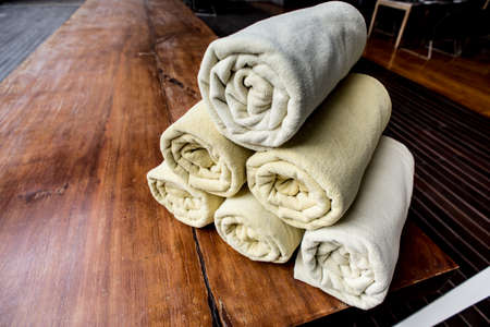 terrycloth: Rolled up white towels at the spa Stock Photo